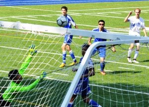Haldane's Seth Warren (14) watches as his shot sails just below the crossbar to put the Blue Devils up 2-0 against Yonkers Montessori Academy Sept. 10.(Photo by Peter Farrell)