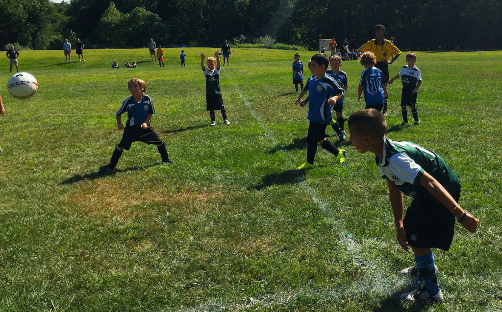 The U8 Storm (in blue) played together for the first time on Sept. 11 against the Yorktown Fire. (Photo provided)