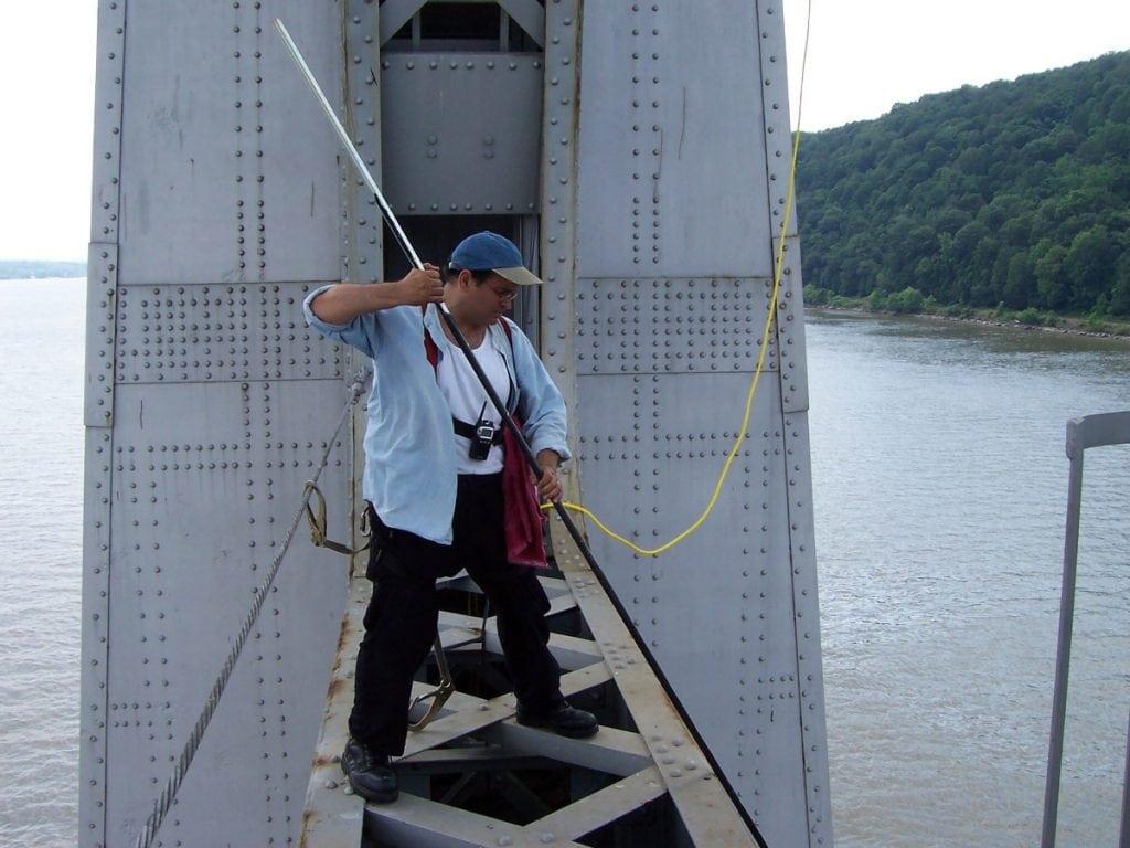 Joseph Bertolozzi bowing a cross frame of the Mid-Hudson Bridge (Photo provided)