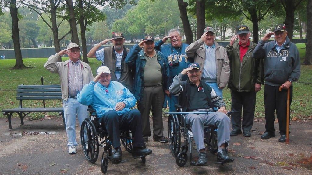 "Anine-veteranColdSpringsalute.""TheWall,""theVietnamVeteransWarMemorialisinthebackground. (PhotobyGregGunder)"