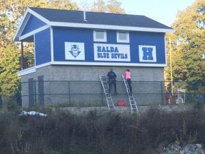 Putting the finishing touches on Haldane's new concession stand and press box