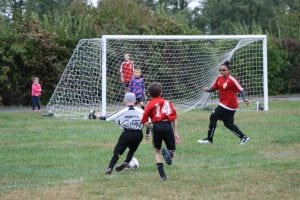 Jake Powers dribbling toward the goal on Oct. 2 for the Philipstown Soccer Club's U11 Strikers. (Photo by Patrice Delabie)