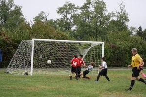 Trajan McCarthy scores one of his two goals on Oct. 2 for the Philipstown Soccer Club's U11 Strikers (Photo by Patrice Delabie)