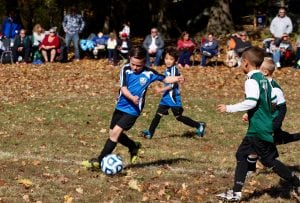 In a U8 soccer matchup on Oct. 22, Joe Demarco of the Philipstown Storm turns the ball around against Yorktown.(Photo by Sheila Williams)