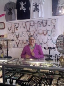 Marlene Goodrich behind the counter at Momminia (store photo)