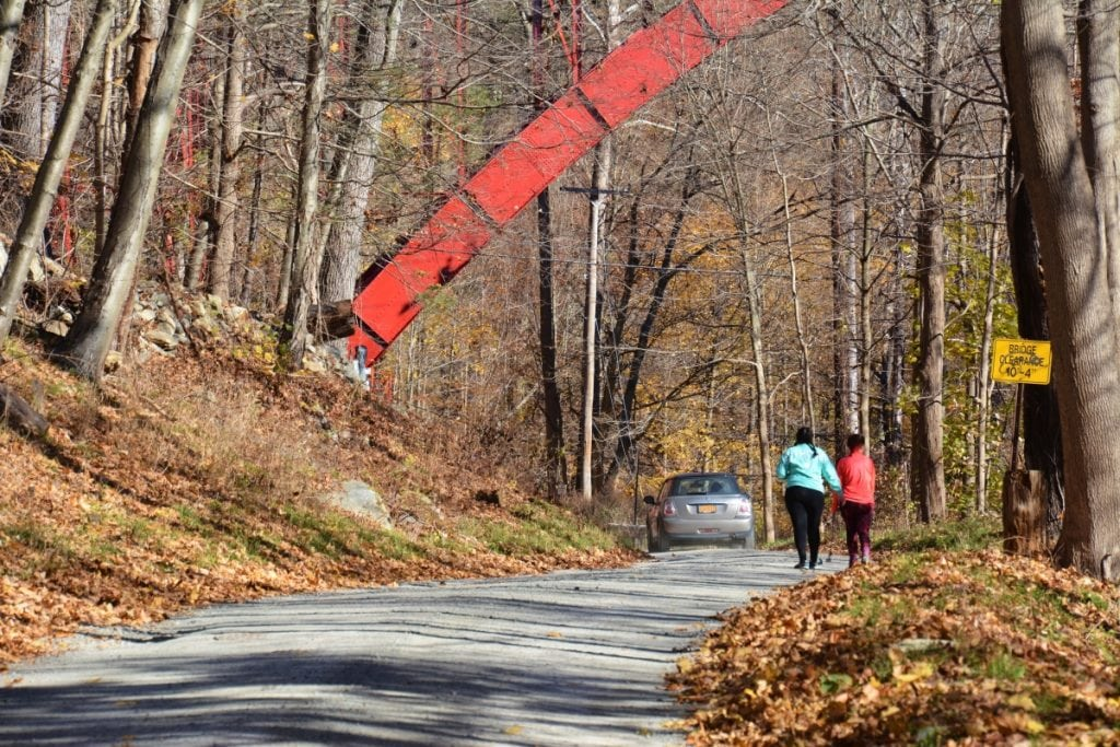 A car sweeps by Megan Oliveri and Grace Razzuno, who came from Long Island, as they head toward Indian Brook Falls. (Photo by L.S. Armstrong)