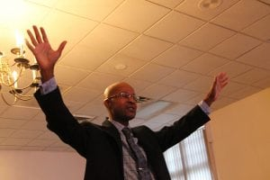Pastor David Bass worships with his congregation at Peak Community Church. (Photo by M.A. Ebner)