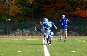 Hunter Erickson kicking a field goal during the 3/4 Tackle team's game against Armonk (Photo by Sheila Williams)