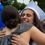 Teresa Figueiras greets a well-wisher at Haldane graduation.