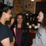 Cupoccino's Jesse Arguello (left) speaks to Haldane ninth graders Natalie Sandick and Grace Tomann about the We Are Cold Spring story project. (Photo by M. Turton)