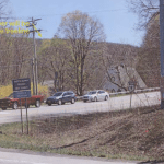 A photograph from a consultant's report shows where the top of the tower would be visible above the treeline at the intersection of routes 9 and 301.