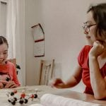 Sakura Ozaki homeschooling her daughter Helena, 11, at the kitchen table (Photo by A. Peltonen)