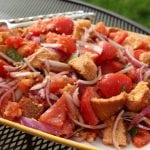 Give day-old bread a second chance by tossing it with a few basic ingredients to make panzanella. (Photo by M.A. Ebner)