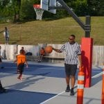 Wayne Griffin, one of the two founders of Beacon Hoops, officiates a game on Aug. 9. (Photo by J. Simms)