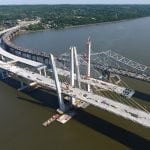 A photo taken June 9 shows the progress on the new two-span bridge in foreground