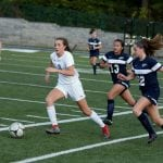 Bela Monteleone (3) advances the ball at home against Putnam Valley on Oct. 17. The Blue Devils, who lost, 2-1, on a late goal, host Hamilton on Oct. 26 in their first game of the state tournament. (Photo by Scott Warren)