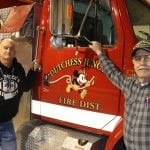 Assistant Chief Sean Barry and Chief John Miller with the Dutchess Junction Fire Department engine and its distinctive Mickey Mouse logo (Photo by M. Turton)
