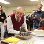 The Village Board threw an early birthday party for Joe Etta at its April 17 meeting. The 1938 Haldane grad, who turns 100 on Sunday, is flanked by his daughter, Maureen Etta, and Mayor Dave Merandy.  (Photo by M. Turton)