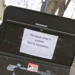 The book-return box was damaged when a vandal tipped it over. (Photo by M. Turton)