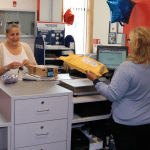 Allison Shea was the first customer at the new post office location in Cold Spring. (Photo by M. Turton)
