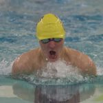 David Reilly on his way to victory in the 100-yard breaststroke (Photo by S. Pearlman)