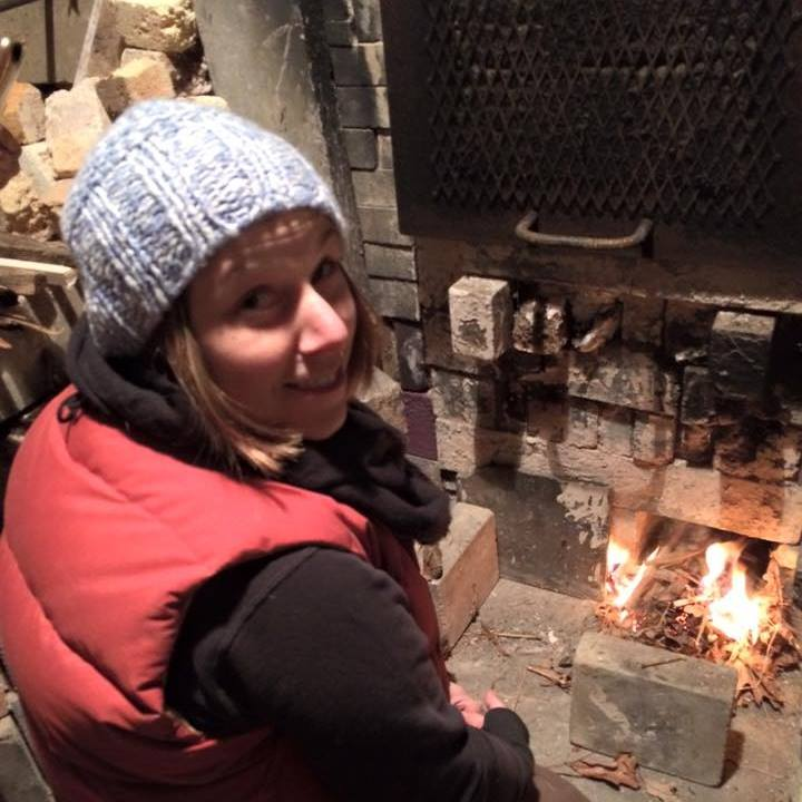 Eileen Sackman at the wood-fired kiln