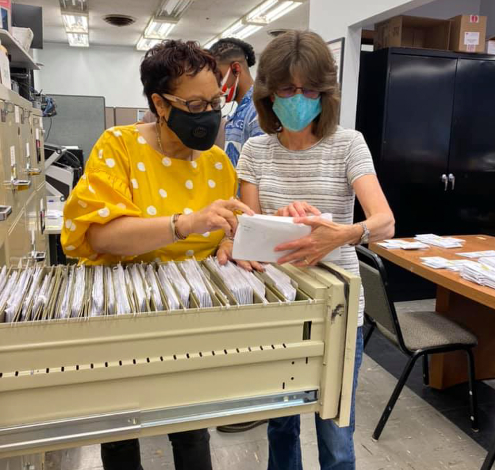 Dutchess election workers process absentee ballots