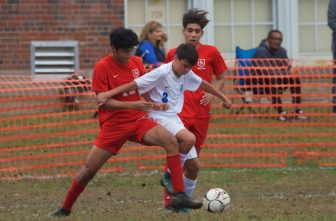 Haldane's Ryan Eng-Wong (8) fought for control against Hamilton defenders in a game last fall.