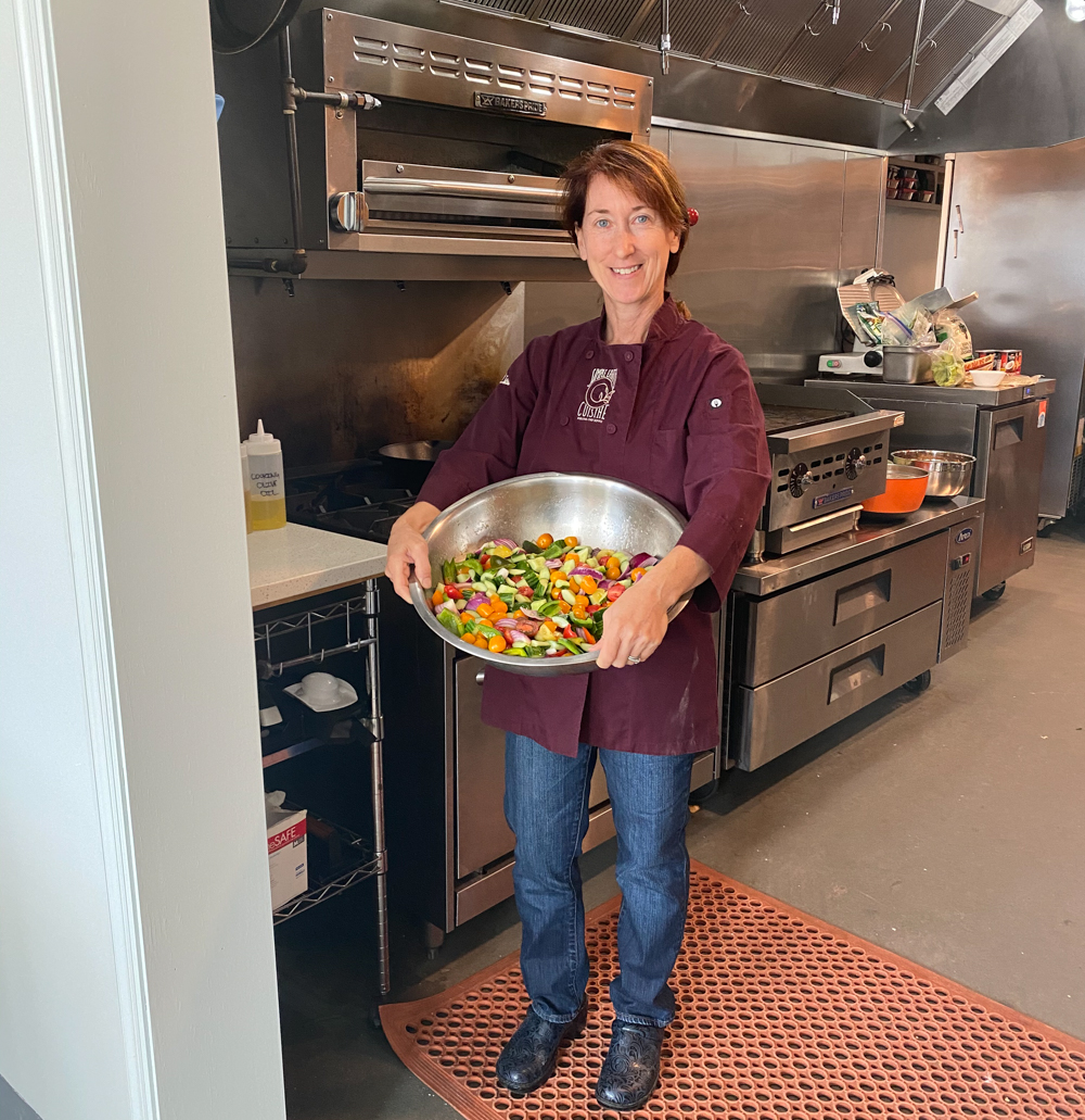Lisa Caccamise, holding her shepherd's salad