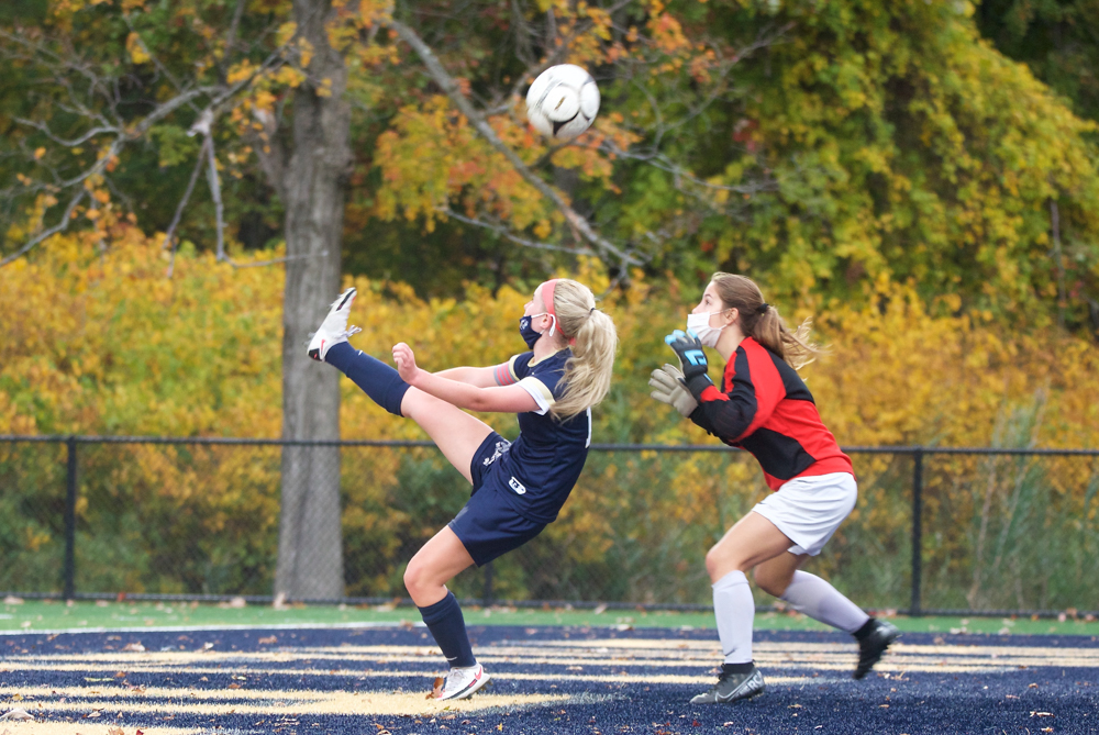 Beacon's Claire Derrenbacher kicks a shot backward over the keeper's head; it barely missed, hitting the top of the goal.