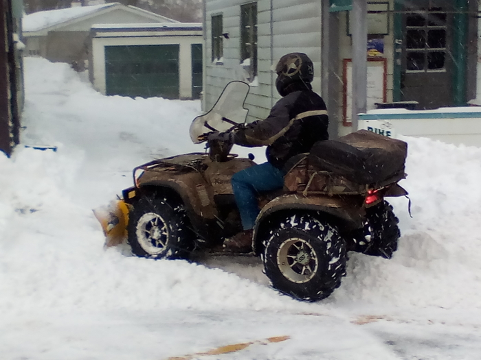ATV Plowing on Main