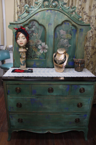 A moody chest of drawers painted and decorated by Judie Gordon