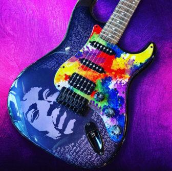 A custom guitar depicting Jimi Hendrix