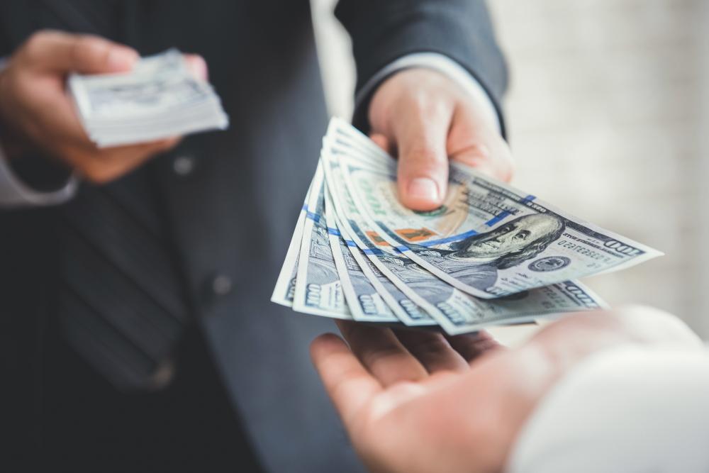 Man handing cash