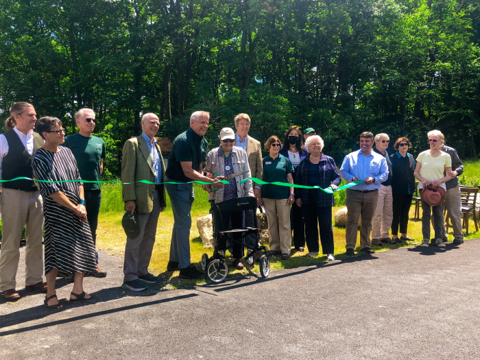State and OSI officials cut the ribbon