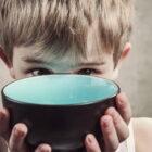 Child holding bowl