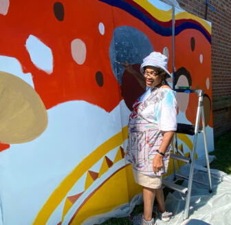 McCannon working on the mural